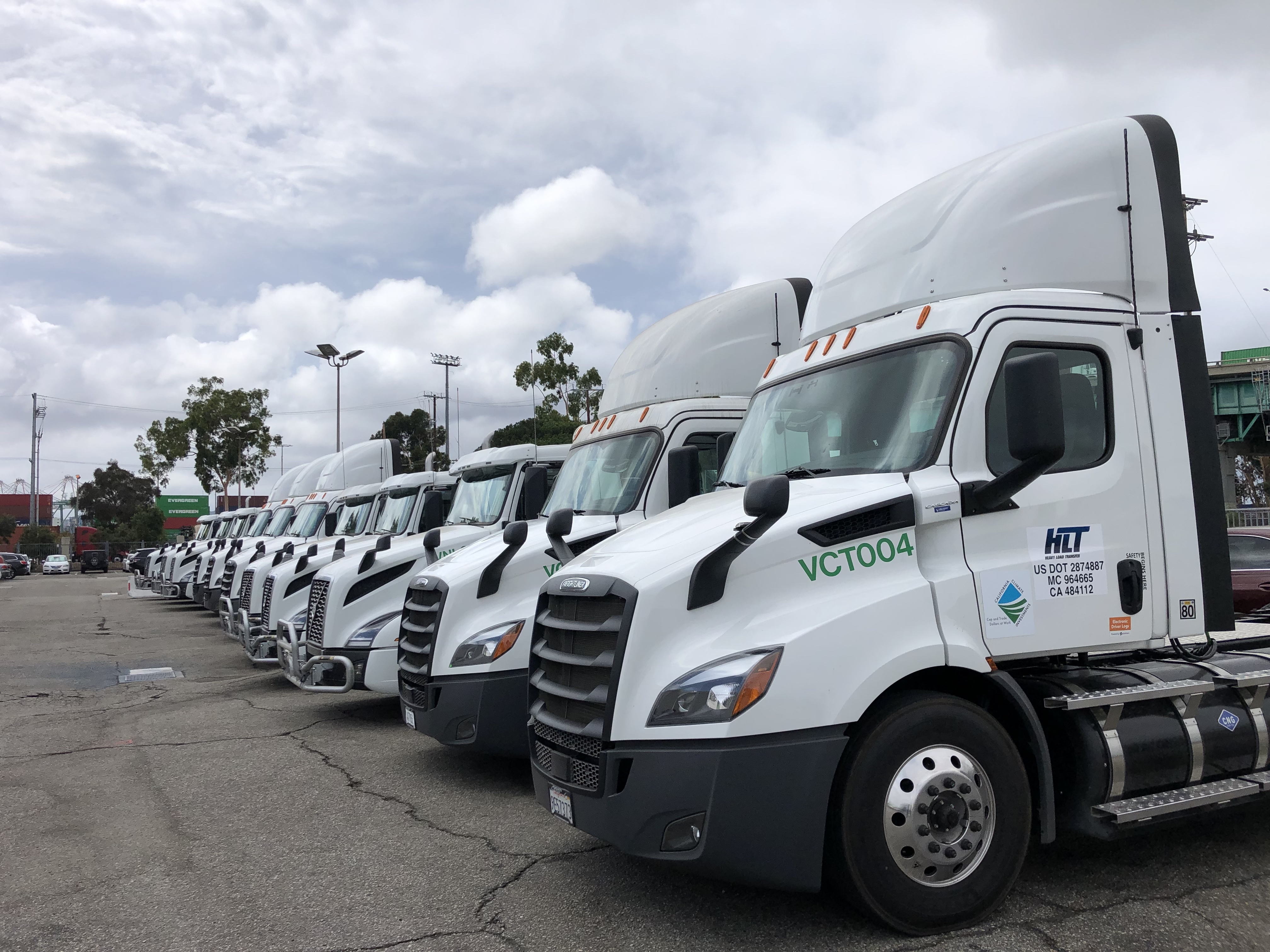 Image of electric heavy-duty trucks lined in a row